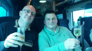 Tom and Owen enjoying champagne on the train from Dublin.