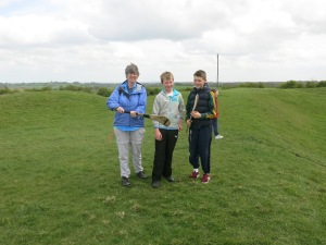Two Irish boys show me a stick used in the Gaelic sport Hurling at the Hill of Tara. Hurling is one of the most popular sports in Ireland.