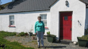 Me in front of the house -- now rebuilt.